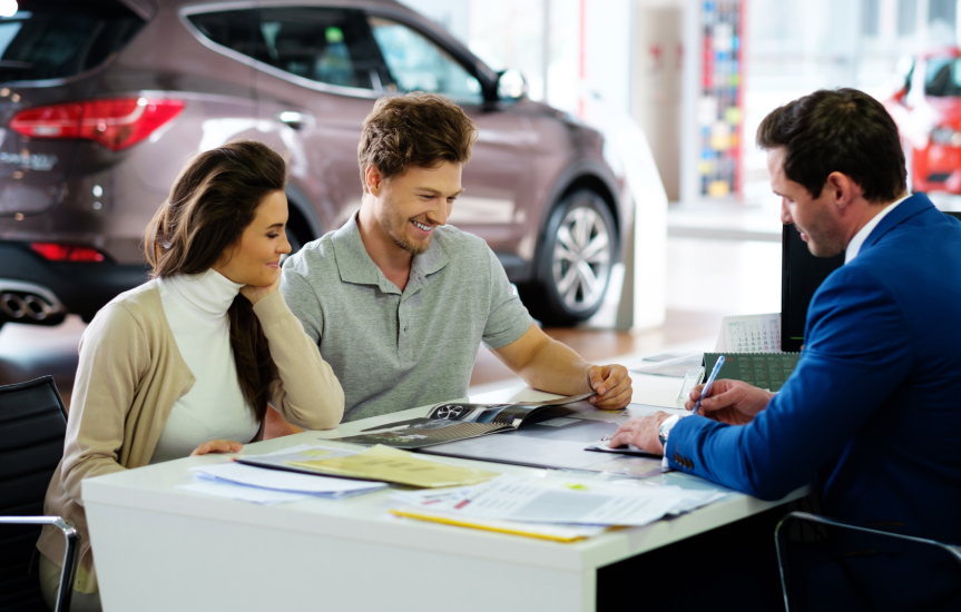 couple in car dealership buying a car
