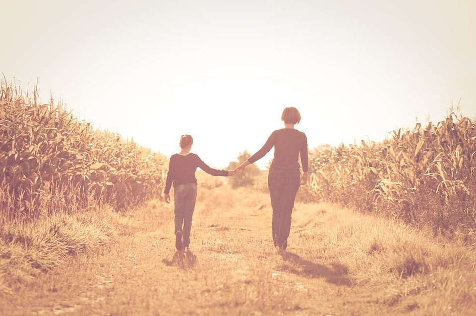 mother daughter walking together hand in hand